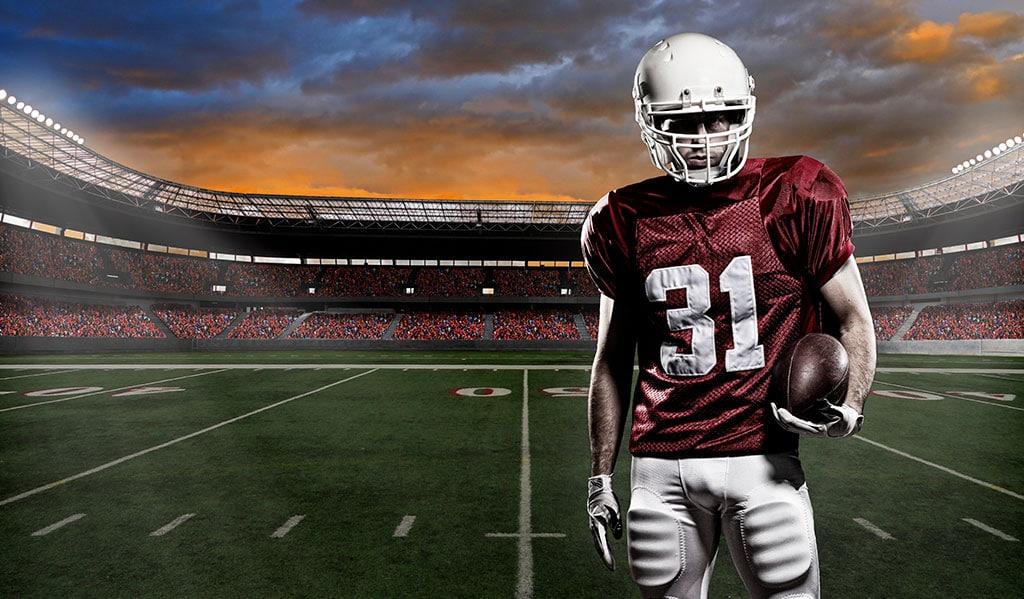 Football player on 50 yard line of football field